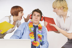 Man Ignores Annoying Co-Workers Stock Images