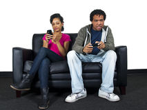 Man ignoring girlfriend while playing video games Stock Photography