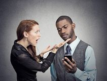 Man ignoring woman obsessed with smartphone stock images