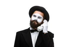 Man in the image mime holding a handset. Royalty Free Stock Photo