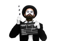 Man in the image mime with movie board Stock Photography