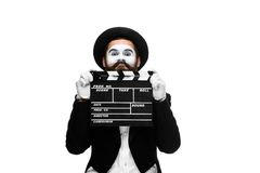 Man in the image mime with movie board Stock Image