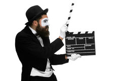 Man in the image mime with movie board Royalty Free Stock Photo