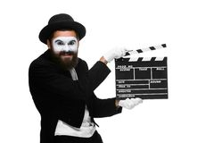 Man in the image mime with movie board Stock Photo