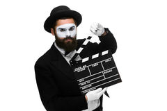 Man in the image mime with movie board Stock Photos
