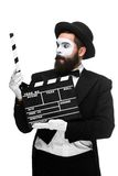 Man in the image mime with movie board Stock Images