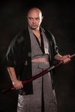 The man in the image of a samurai with sword in hand stock images