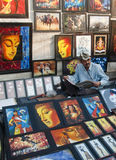 The man with the images. A vendor selling images in a art fair in Bengal, India royalty free stock images