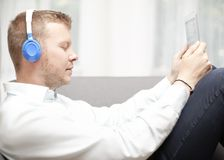 Man immersed in music listening with closed eyes Royalty Free Stock Image