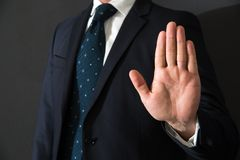 Imposing stop with gesture of a hand. Man imposing stop with gesture of a hand Royalty Free Stock Images
