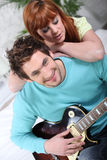 Man impressing girl Stock Photos