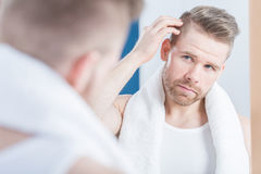 Man improving hair Stock Image