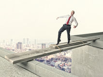 Man on improvised bridge Royalty Free Stock Photo