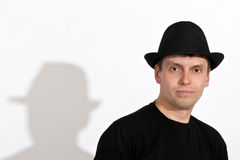 Man In A Black Hat Stock Photo