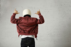 Man In A Bordeaux Pilot Jacket With Helmet Royalty Free Stock Image