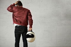 Man In A Bordeaux Pilot Jacket With Helmet Royalty Free Stock Images