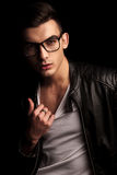 Man In Black Leather And Glasses Pulling His Shirt Stock Photo