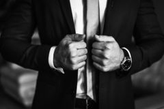 Man In Business Suit. A Man Puts On A Suit. Close-up Business Stylish Man Buttoning His Jacket. A Businessman In An Expensive Suit Stock Photography