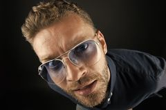 Free Man In Glasses Look With Curious Face On Dark Background Royalty Free Stock Image - 162490506
