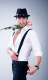 Man In Hat With Pink Rose Stock Image