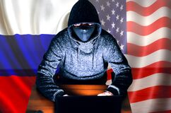 Free Man In Hoodie Is Hacking Personal Data. Information Security. Russian And American Flags. Protection Of Information Concept. Bad Stock Image - 190750991
