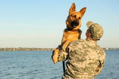 Free Man In Military Uniform With German Shepherd Dog Royalty Free Stock Images - 161048479