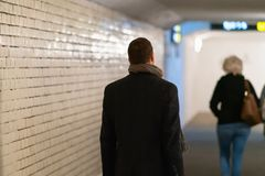 Free Man In Overcoat Following A Woman In Subway Stock Photo - 160446690