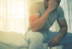 Free Man In Pyjamas Headache On Bed From Hang Over And Stress In Morning Stock Images - 112095694