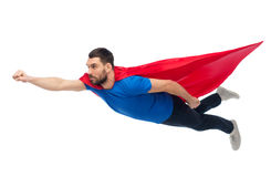 Free Man In Red Superhero Cape Flying On Air Stock Images - 84943294