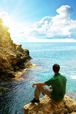 Man In Sea Cave. Stock Photo