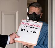 Free Man In Suit Giving Eviction Notice To Renter Or Tenant Of Home Royalty Free Stock Photos - 190070838