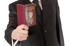 Man In Suit Holding Passport Stock Photo