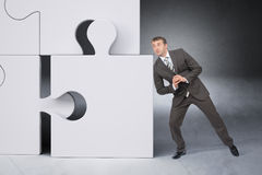 Man In Suit Pushing Puzzle Piece Stock Photos