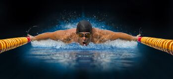 Man In Swimming Pool. Butterfly Style Stock Photo