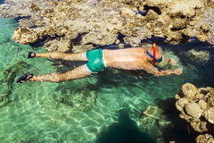 Free Man In The Mask Floats On A Coral Reef In The  Sea Royalty Free Stock Image - 45652146
