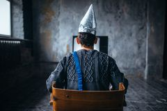 Free Man In Tinfoil Helmet Watches TV, Ufo Phobia Stock Photography - 103715892