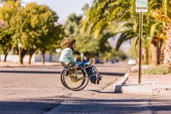 Free Man In Wheelchair Approaching City Curb Royalty Free Stock Photo - 146570065