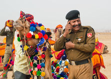 Man in indian military uniform calling by mobile phone Stock Images
