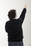 Man indicates a point at the top Stock Image