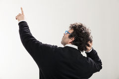 Man indicates a point at the top Royalty Free Stock Photos