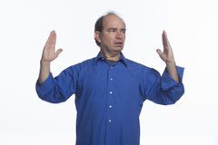 Man indicating large size with hands, horizontal Royalty Free Stock Image