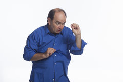 Man indicating small size with fingers, horizontal Stock Image