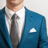 Man in indigo suit Royalty Free Stock Images
