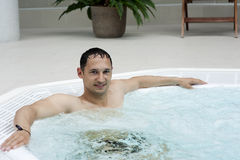 Man in indoor jacuzzi Stock Image
