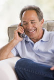 Man indoors using telephone smiling.  royalty free stock photos