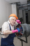 Man with industrial heater Royalty Free Stock Image