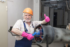 Man with industrial heater Stock Photo