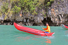 Man in an inflatable canoe near Ko Tapu island royalty free stock images