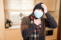 Man with influenza and sore throat Stock Photo