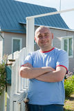 Man infront of his house Royalty Free Stock Photo
